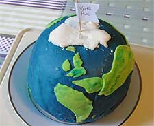 Photo of birthday cake in the shape of the world