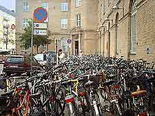 Bicycles parked in a busy city street