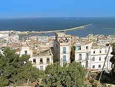 Cityscape picture of Algiers, showing the coastline
