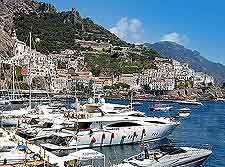 Amalfi beachfront image, showing marina and luxury yachts