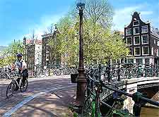 Picture of cyclist in central Amsterdam, image by Jorge Royan