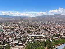 Aerial view of the city and distant mountains