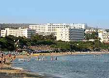 Picture of beachfront accommodation and tourists