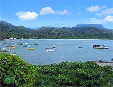 Photo of the bay, showing the El Yunque mountain in the distance