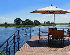 Waterfront photo showing dining table at Chobe Lodge
