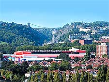 Photo showing the Ashton Gate Stadium and the distant Clifton Suspension Bridge