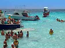Photo of crystal clear waters and snorkellers