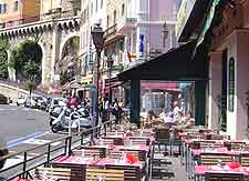 Photo of cafe and pavement tables in the sunshine