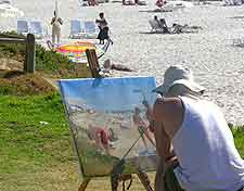 Picture of artist painting at Camps Bay