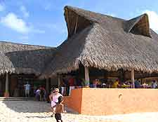 Image of beachfront restaurant, with thatched roof