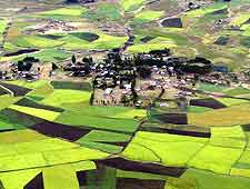 Aerial view, showing the lush patchwork of fields and plantations