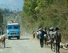 Photo of local bus and dusty road