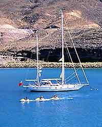 Photograph showing a sailing boat off Fuerteventura's Corralejo coastline