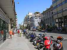 Photo of a Granada street lined with mopeds