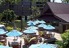 Hawaii Big Island photo of tables and parasols by the pool
