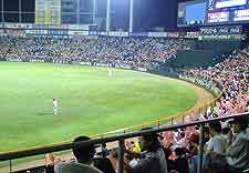 Picture of crowds watching a game of baseball at the city's Municipal Baseball Stadium