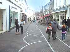 Another photo of shoppers in St. Helier