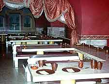 View of eatery tables set for dinner