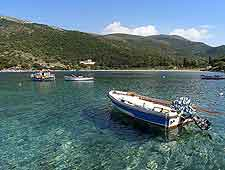 Picture of boat and coastline, basking in sunshine
