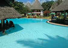 Picture showing Kenyan resort complex with swimming pool
