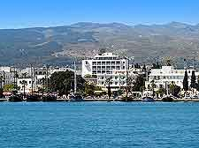 Photo of Kos Town waterfront, showing hotels and surrounding hills