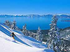 Image of winter skier zooming down the slopes