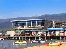 Picture of beachfront restaurant and summer tourists