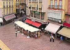 Photo of restaurants surrounding a Malaga plaza