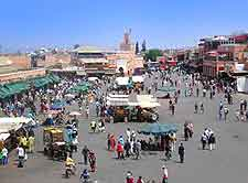 Photo of central Djemaa El Fna market and tourists