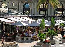 Image of al fresco diners, shaded by parasols