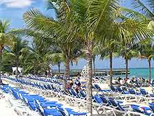 Photograph of sunloungers on beachfront at Montego Bay