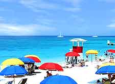 Picture of sunbathers and colourful parasols on Doctor's Cave Beach