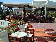 Image of cafe tables and parasol