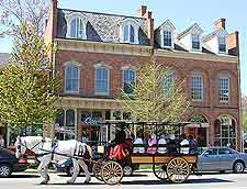 Photo showing tourists enjoying a horse and carriage ride