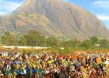 Photo of Abuja carnival celebrations, with Aso Rock in the background
