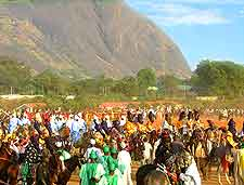 Photo of Abuja Carnival celebrations, showing Aso Rock in the background