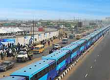 Image of buses queued up and awaiting passengers in Lagos