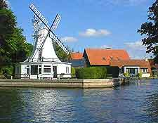 Photo of a Norfolk Broads riverfront windmill