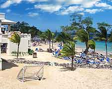 Picture of holiday makers soaking up the sun on the beach at Ocho Rios