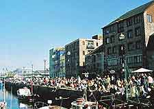Photo of crowds gathered along the Barbican waterfront