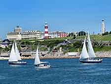 Photo of sailing boats passing the Hoe