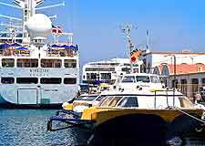 Photograph showing local ferries, collecting passengers