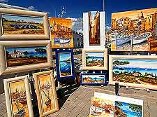 Picture of St. Tropez local artist's paintings, displayed on the quay