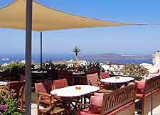 Image of al fresco cafe tables, with coastal view
