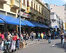 Photograph of downtown stores and tourists