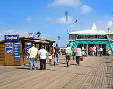 View of summer holiday makers strolling on Paignton Pier