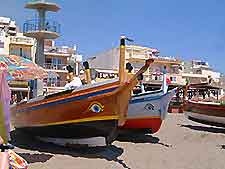 Picture showing boats along the beachfront