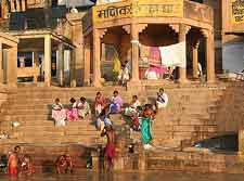 Photo of locals paying at a waterfront ghat