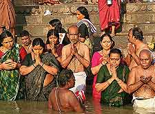 Close-up picture showing locals praying in the River Ganges